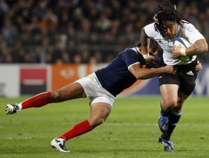 New Zealand All Blacks Ma'a Nonu is challenged by France's David Marty during their rugby test match at the Velodrome stadium in Marseille